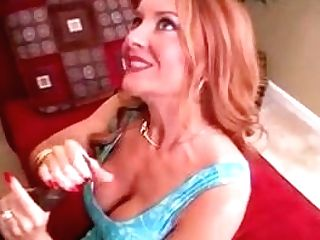 Cougar Sandy-haired Strokes Big Black Cock Until He Nuts In Her Cleavage
